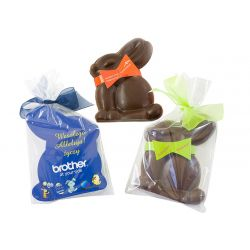 Chocolate Easter bunny in transparent bag and your branding printed to the backing card and bow around bunny's neck.