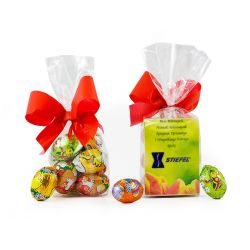 Clear foil gift bag with 6 flavoured mini eggs wrapped in Easter themed foil. Bag tied with a coloured ribbon and small personalised card inside.