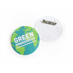 Circular badge made from recycled paper embedded with wildflower seeds and branded with your details.